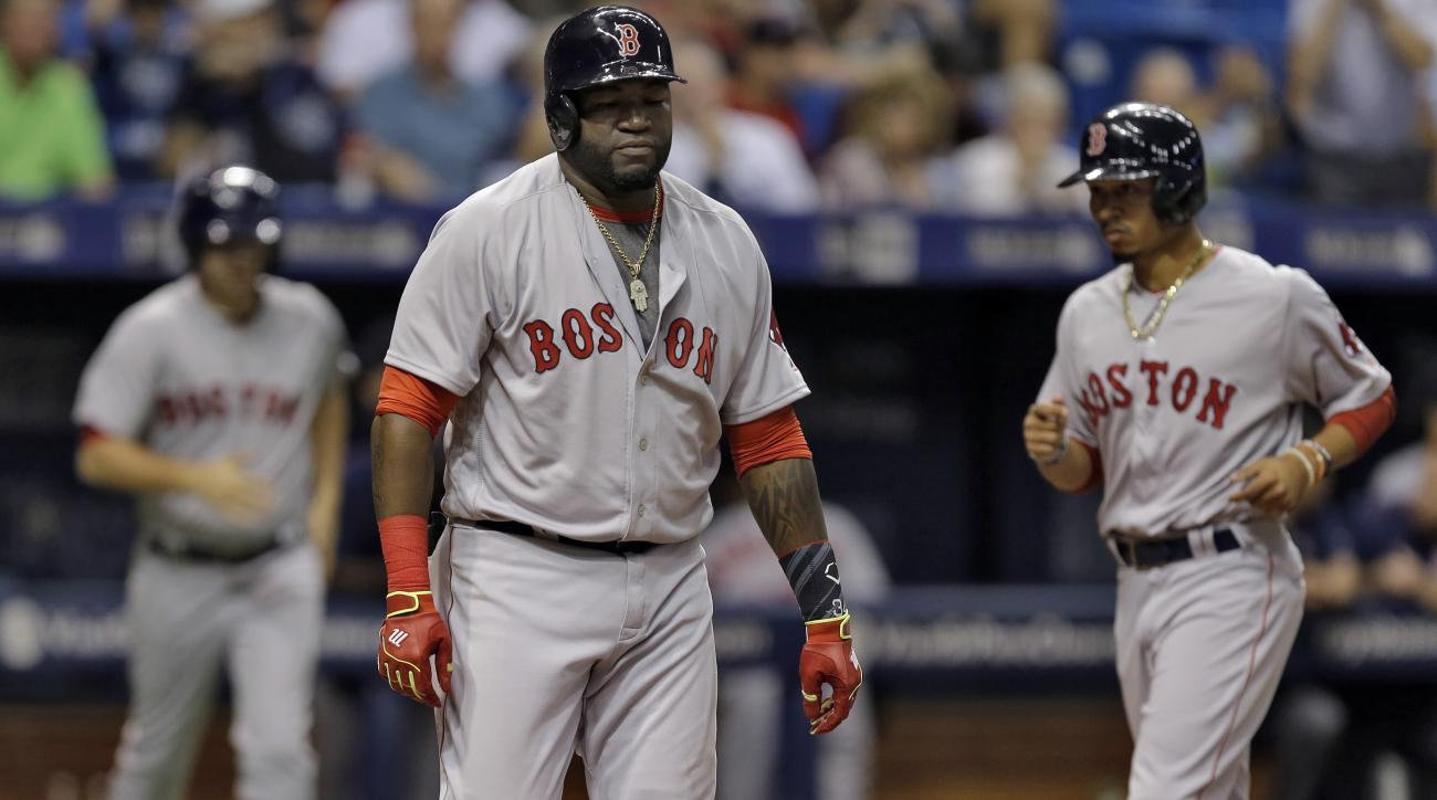 Boston Red Sox's David Ortiz draws a bases loaded walk from Tampa Bay Rays' Blake Snell as Mookie Betts, right, scores during the fifth inning of a baseball game Monday, June 27, 2016, in St. Petersburg, Fla. (AP Photo/Chris O'Meara)