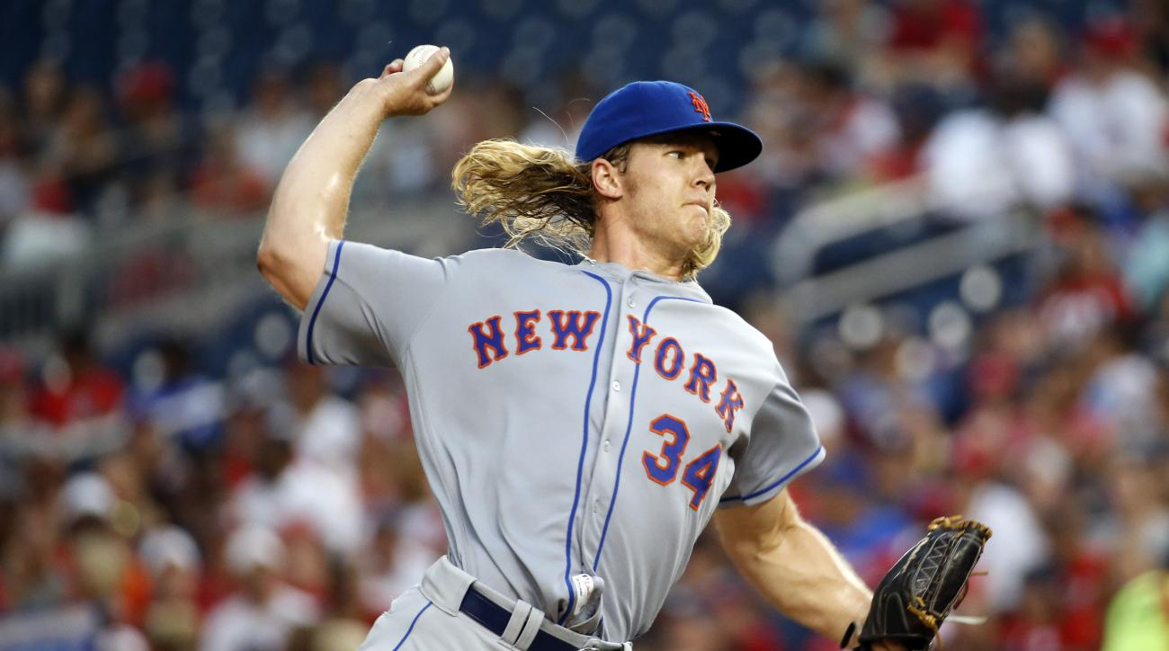New York Mets starting pitcher Noah Syndergaard throws during the second inning of a baseball game against the Washington Nationals at Nationals Park, Monday, June 27, 2016, in Washington. (AP Photo/Alex Brandon)