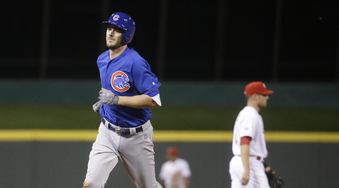 Chicago Cubs' Kris Bryant runs the bases on a solo home run off Cincinnati Reds relief pitcher Ross Ohlendorf in the eighth inning of a baseball game, Monday, June 27, 2016, in Cincinnati. (AP Photo/John Minchillo)