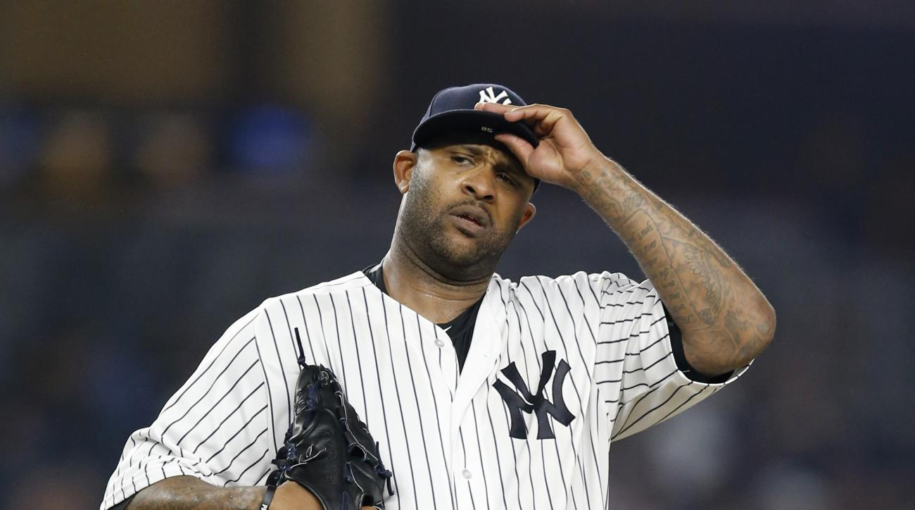 New York Yankees starting pitcher CC Sabathia reacts on the mound during the eighth inning of a baseball game against the Texas Rangers in New York, Tuesday, June 28, 2016. (AP Photo/Kathy Willens)