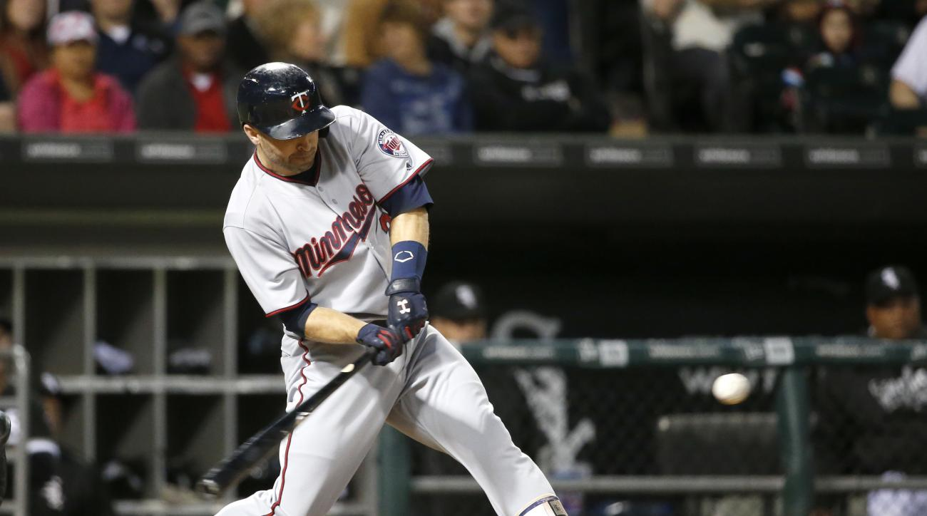 Minnesota Twins' Brian Dozier swings on a three-run home run off Chicago White Sox starting pitcher Jose Quintana during the sixth inning of a baseball game Tuesday, June 28, 2016, in Chicago.  (AP Photo/Charles Rex Arbogast)