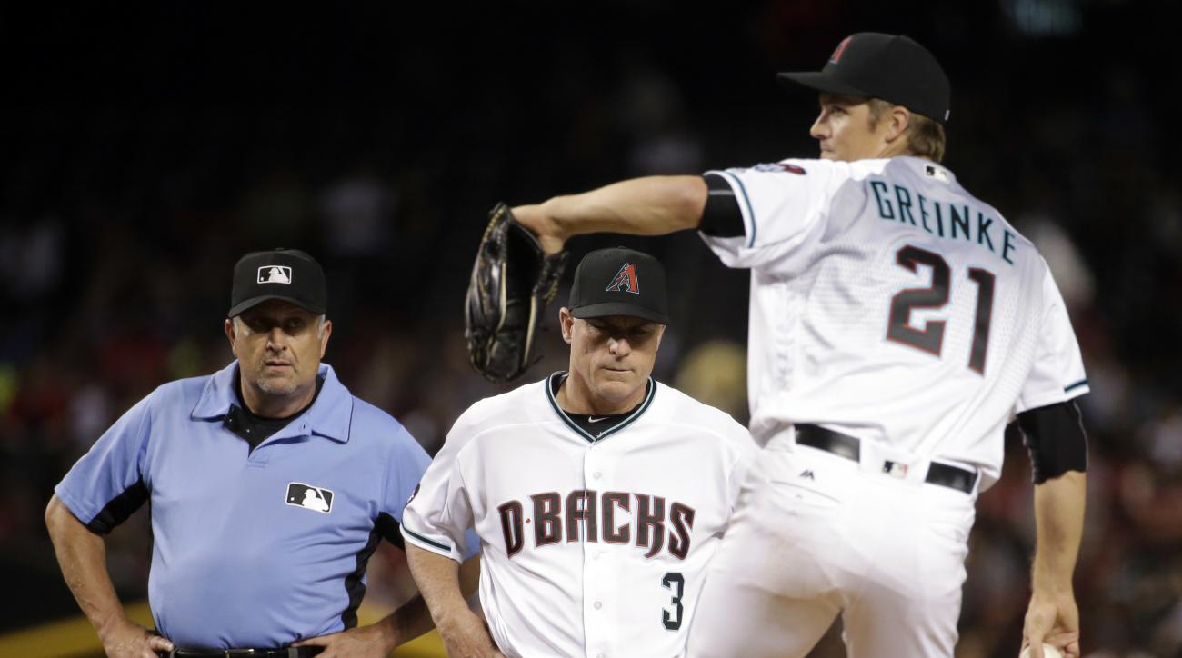 Arizona Diamondbacks manager Chip Hale (3) watches as Arizona Diamondbacks Zack Greinke (21) throws after a stop in the game against the Philadelphia Phillies during the third inning of a baseball game, Tuesday, June 28, 2016, in Phoenix. Greinke was remo