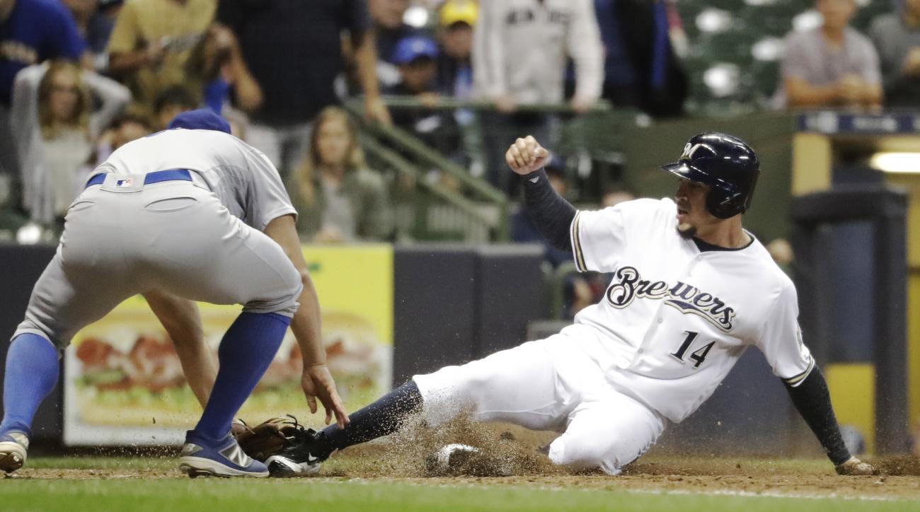 Los Angeles Dodgers' Joe Blanton tags Milwaukee Brewers' Hernan Perez (14) not at home during the eighth inning of a baseball game Tuesday, June 28, 2016, in Milwaukee. Perez tried to score from second on a ball that got passed catcher Yasmani Grandal. (A