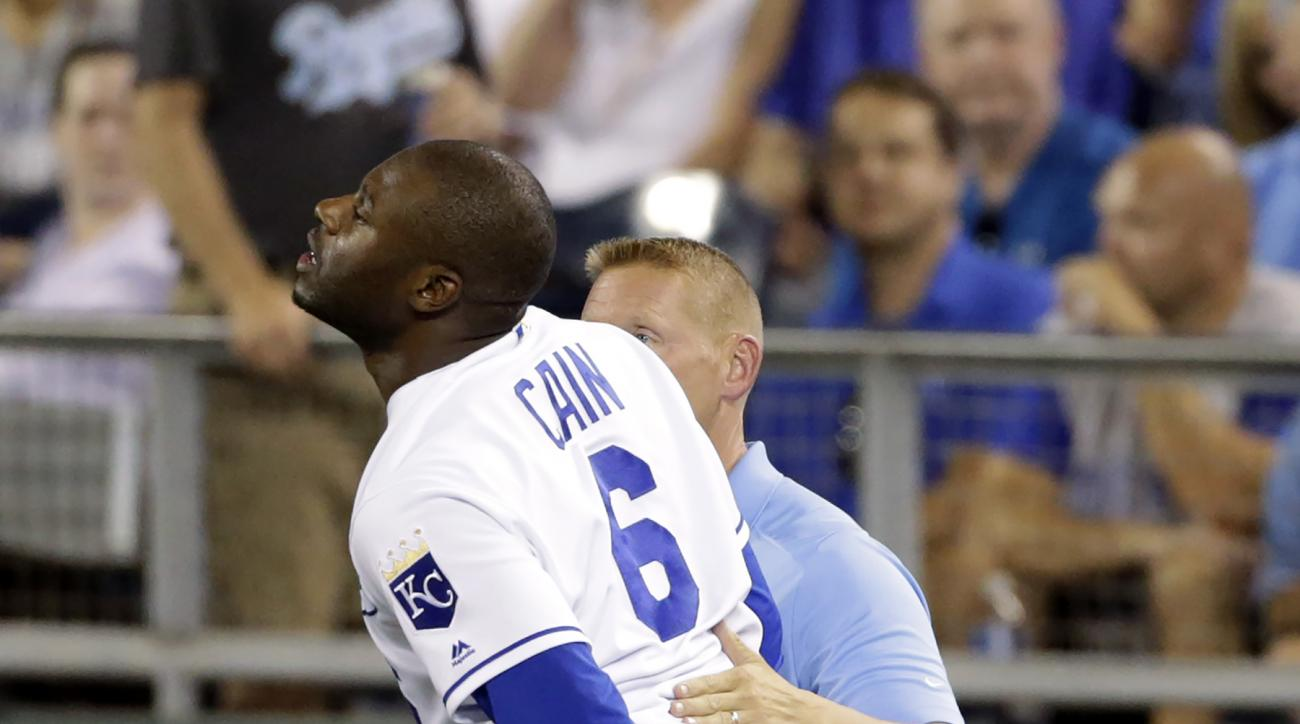 Kansas City Royals Lorenzo Cain reacts after injuring his leg running to first base in the ninth inning of a baseball game against the St. Louis Cardinals at Kauffman Stadium in Kansas City, Mo., Tuesday, June 28, 2016. The Cardinals beat the Royals 8-4.