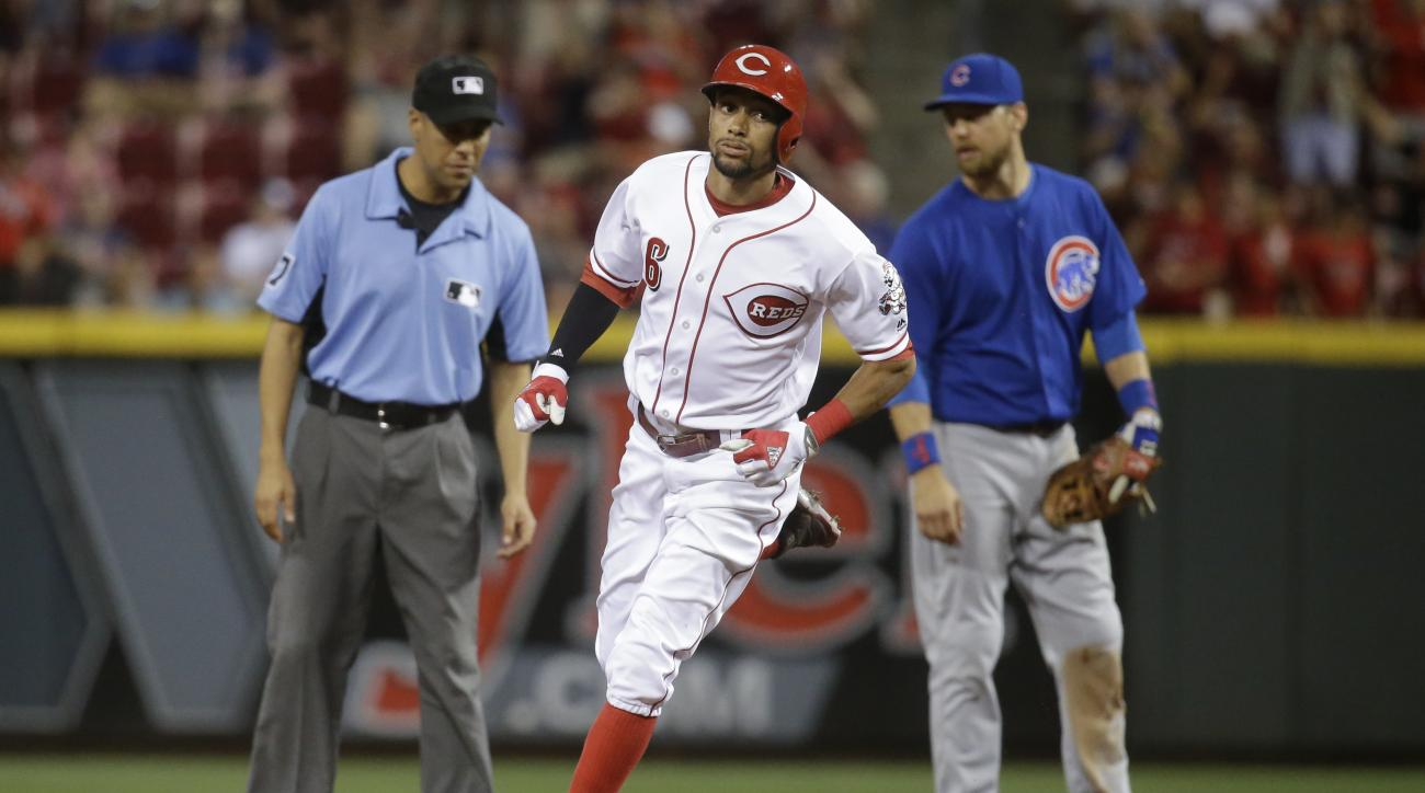 Cincinnati Reds' Billy Hamilton runs the bases after hitting a solo home run off Chicago Cubs starting pitcher Jon Lester during the eighth inning of a baseball game Tuesday, June 28, 2016, in Cincinnati. The Cubs won 7-2 in 15 innings. (AP Photo/John Min