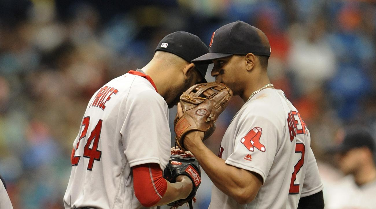 Boston Red Sox second baseman Xander Bogaerts, right, talks with starter David Price on the mound during the third inning of a baseball game Wednesday, June 29, 2016, in St. Petersburg, Fla. (AP Photo/Steve Nesius)