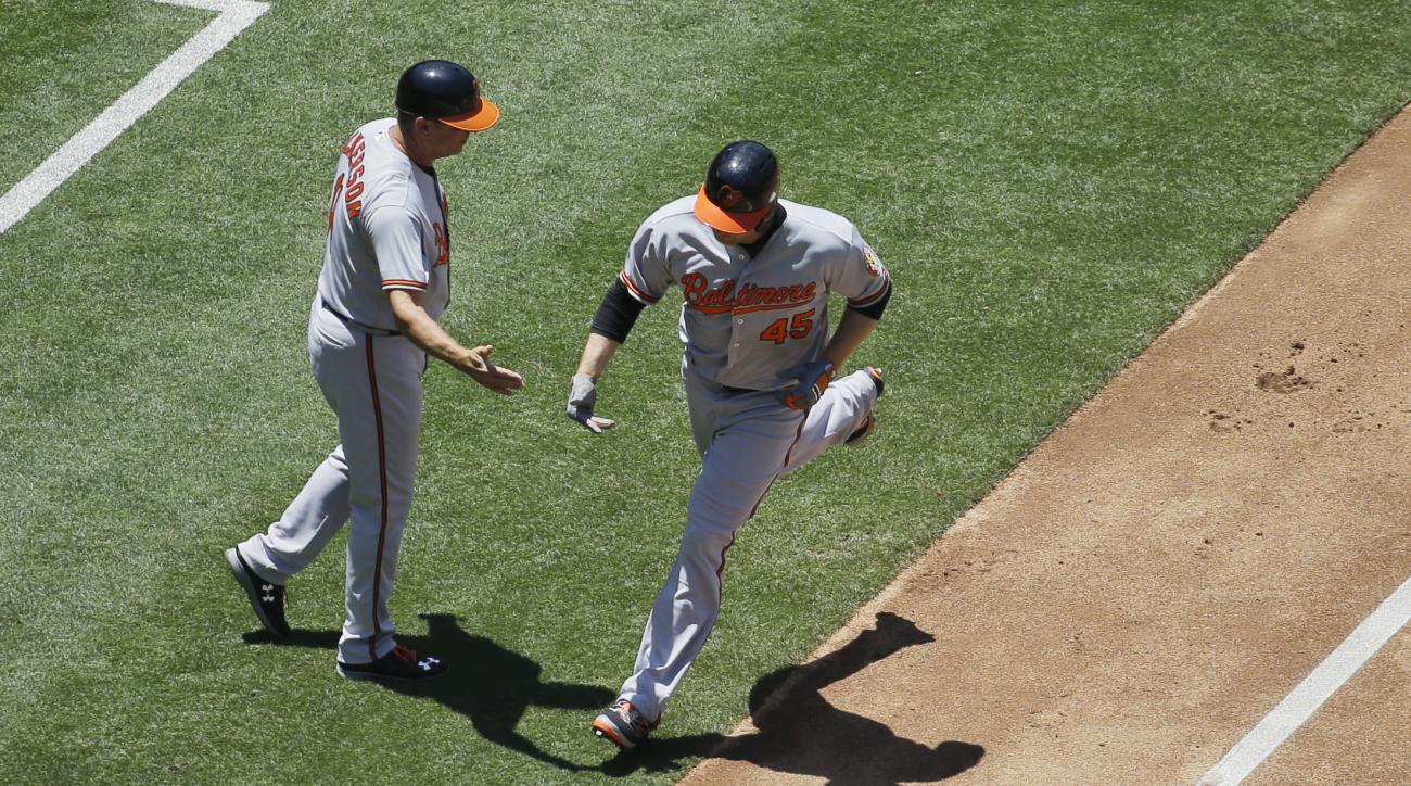 Baltimore Orioles' Mark Trumbo, right, is greeted by third base coach Bobby Dickerson after hitting a two-run home run during the fourth inning of a baseball game against the San Diego Padres, Wednesday, June 29, 2016, in San Diego. (AP Photo/Gregory Bull