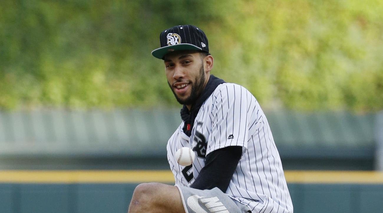 Chicago Bulls first-round draft pick Denzel Valentine plays with the ball before throwing out a ceremonial first pitch before a baseball game between the Minnesota Twins and the Chicago White Sox in Chicago, Wednesday, June 29, 2016. (AP Photo/Nam Y. Huh)