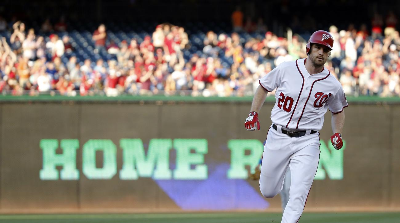 Washington Nationals' Daniel Murphy rounds the bases on a solo home run during the second inning of a baseball game against the New York Mets at Nationals Park, Wednesday, June 29, 2016, in Washington. (AP Photo/Alex Brandon)