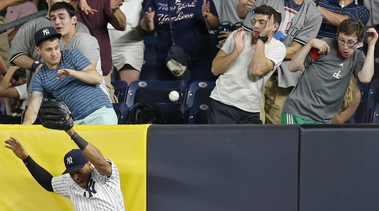 New York Yankees right fielder Aaron Hicks (31) reacts being unable to catch Adrian Beltre's sixth-inning solo home run in a baseball game against the Texas Rangers in New York, Wednesday, June 29, 2016. (AP Photo/Kathy Willens)