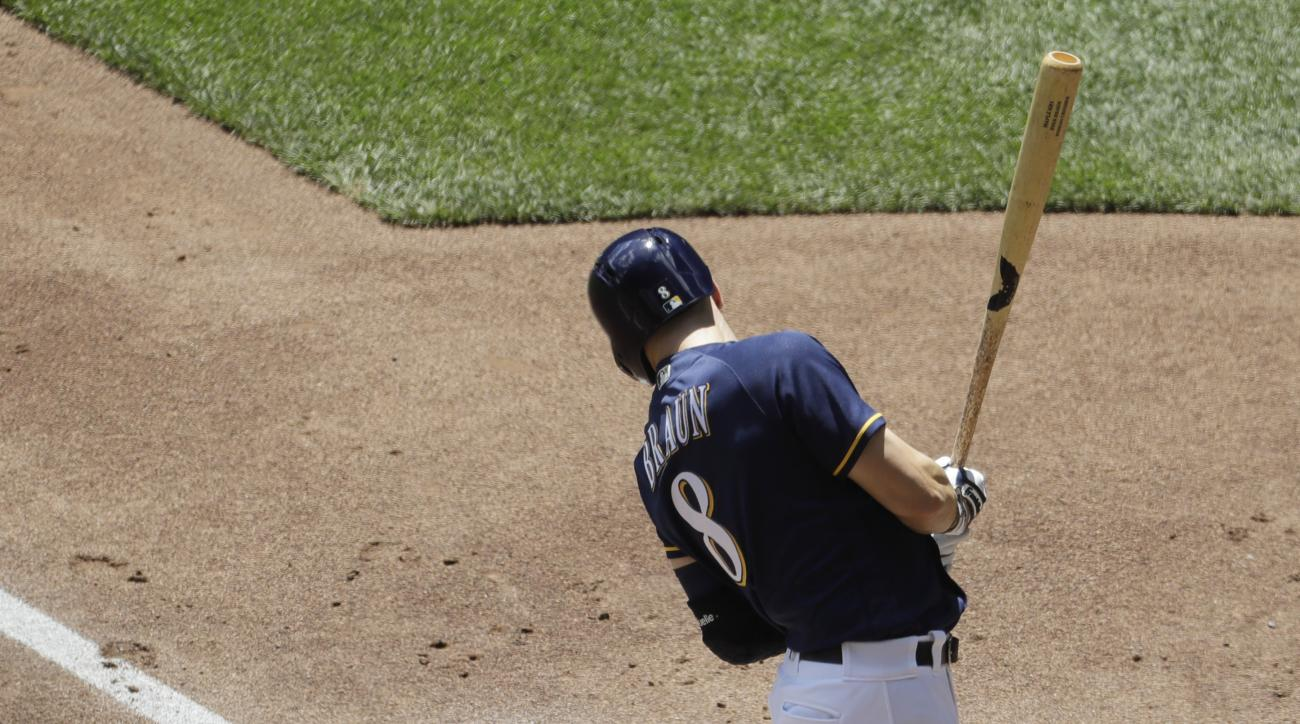 Milwaukee Brewers' Ryan Braun is hit by a pitch during the first inning of a baseball game against the Los Angeles Dodgers Thursday, June 30, 2016, in Milwaukee. (AP Photo/Morry Gash)
