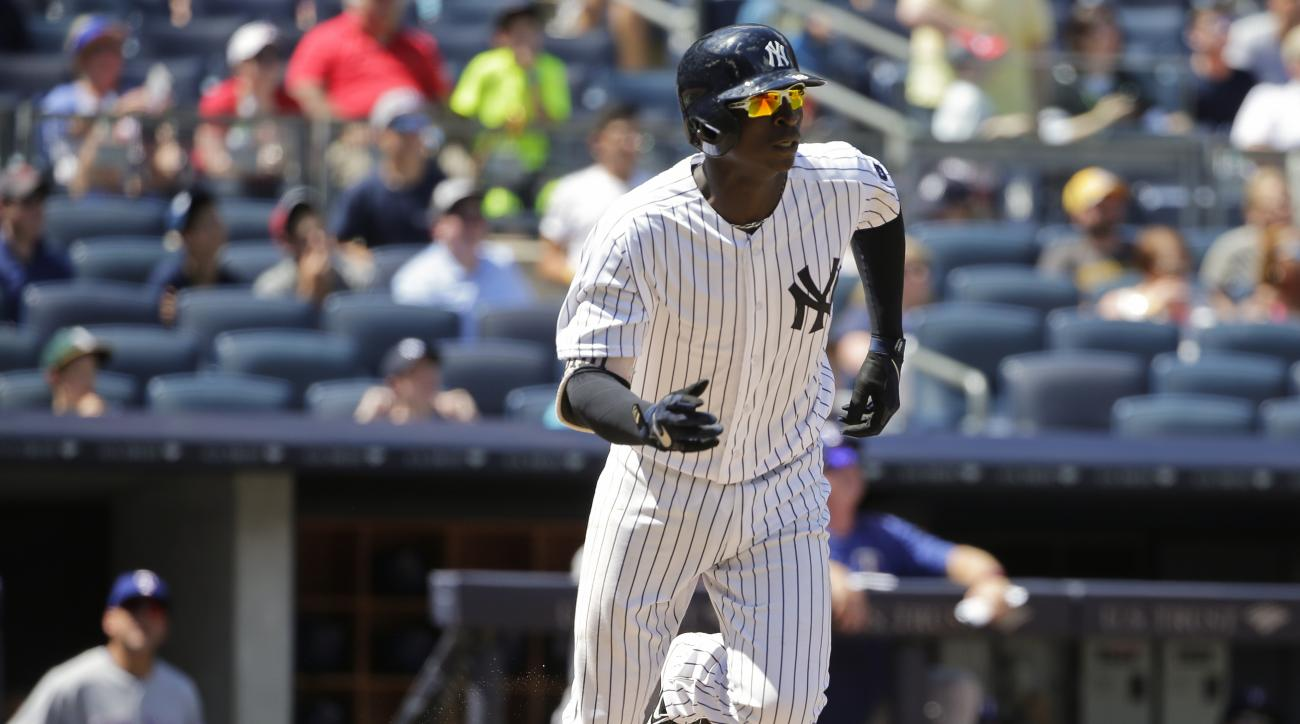 New York Yankees' Didi Gregorius tosses his bat after hitting a home run during the fifth inning of a baseball game against the Texas Rangers Thursday, June 30, 2016, in New York. (AP Photo/Frank Franklin II)