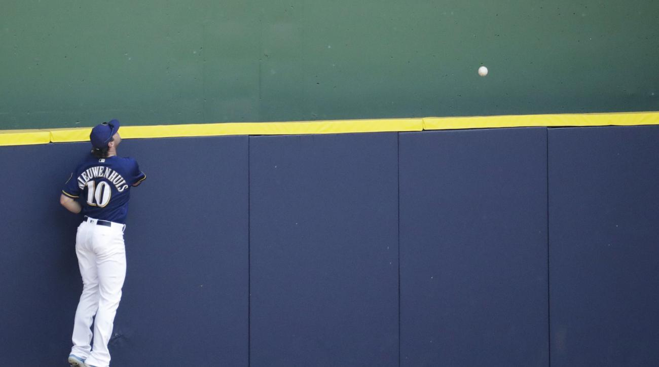 Milwaukee Brewers' Kirk Nieuwenhuis watches a two-run home run hit by Los Angeles Dodgers' Corey Seager during the fifth inning of a baseball game Thursday, June 30, 2016, in Milwaukee. (AP Photo/Morry Gash)