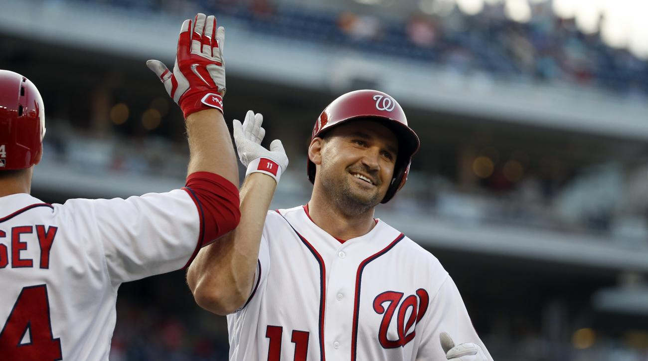 Washington Nationals' Ryan Zimmerman (11) celebrates his three-run homer with Chris Heisey during the first inning of a baseball game against the Cincinnati Reds at Nationals Park, Thursday, June 30, 2016, in Washington. (AP Photo/Alex Brandon)
