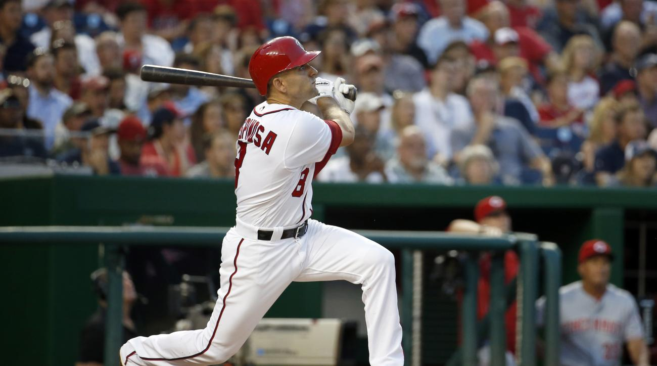 Washington Nationals' Danny Espinosa watches his grand slam off of Cincinnati Reds starting pitcher Brandon Finnegan during the third inning of a baseball game, Thursday, June 30, 2016, in Washington. (AP Photo/Alex Brandon)
