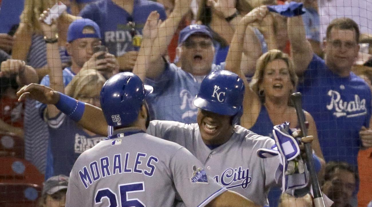Kansas City Royals' Kendrys Morales, left, gets a hug from Salvador Perez after hitting a solo home run during the eighth inning of a baseball game against the St. Louis Cardinals Thursday, June 30, 2016, in St. Louis. (AP Photo/Jeff Roberson)