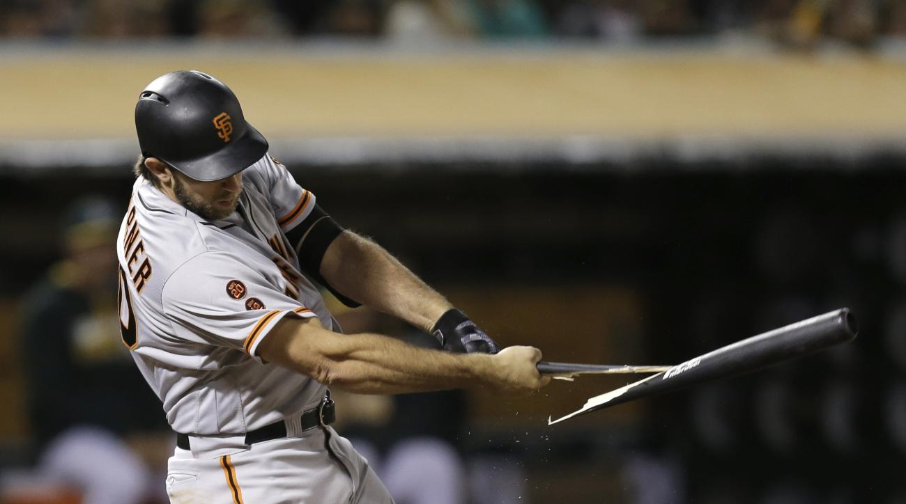 San Francisco Giants' Madison Bumgarner shatters his bat on a pitch from Oakland Athletics' Daniel Coulombe during the seventh inning of a baseball game Thursday, June 30, 2016, in Oakland, Calif. (AP Photo/Ben Margot)