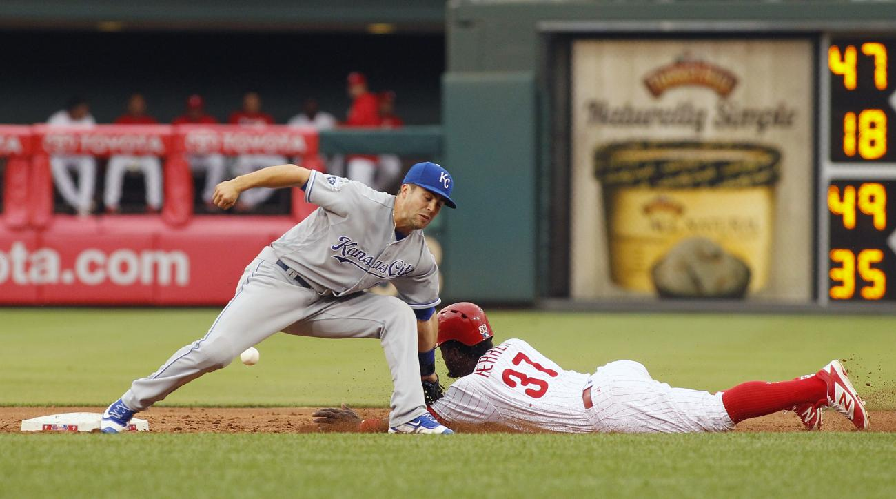 Philadelphia Phillies' Odubel Herrera, right, steals second as the throw from the plate to Kansas City Royals' Whit Merrifield goes past during the third inning of a baseball game, Friday, July 1, 2016  in Philadelphia. Herrera advanced to third and Royal
