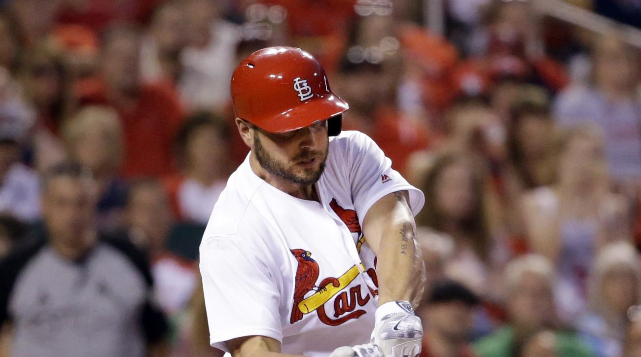 St. Louis Cardinals' Matt Holliday hits a two-run single during the fourth inning of a baseball game against the Milwaukee Brewers, Friday, July 1, 2016, in St. Louis. (AP Photo/Jeff Roberson)