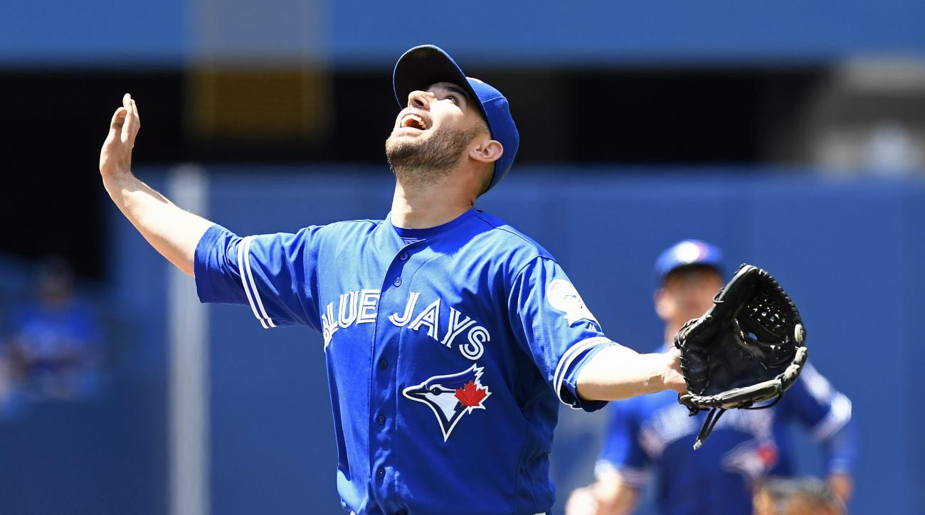 Toronto Blue Jays starting pitcher Marco Estrada calls for a pop fly during the fifth inning of a baseball game, Saturday, July 2, 2016, in Toronto. (Frank Gunn/The Canadian Press via AP)
