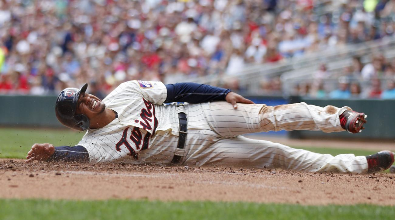 Minnesota Twins Eduardo Escobar is hurt as he scores in the first inning against the Texas Rangers during a baseball game on Saturday, July 2, 2016 in Minneapolis.(AP Photo/Andy Clayton-King)