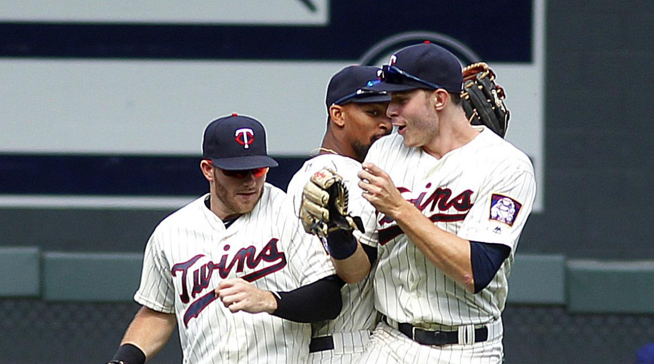 Minnesota Twins outfielders including Max Kepler, right, Byron Buxton, center, and Robbie Grossman jump together in celebration after a baseball game against the Texas Rangers on Saturday, July 2, 2016 in Minneapolis. The Twins defeated the Rangers 17-5.(