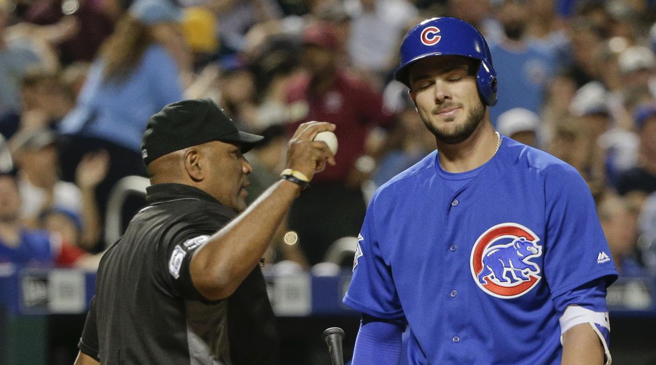Chicago Cubs' Kris Bryant, right, reacts after being called out on strikes by home plate umpire Laz Diaz, left, to end the top of the fifth inning of a baseball game against the New York Mets, Saturday, July 2, 2016, in New York. (AP Photo/Julie Jacobson)