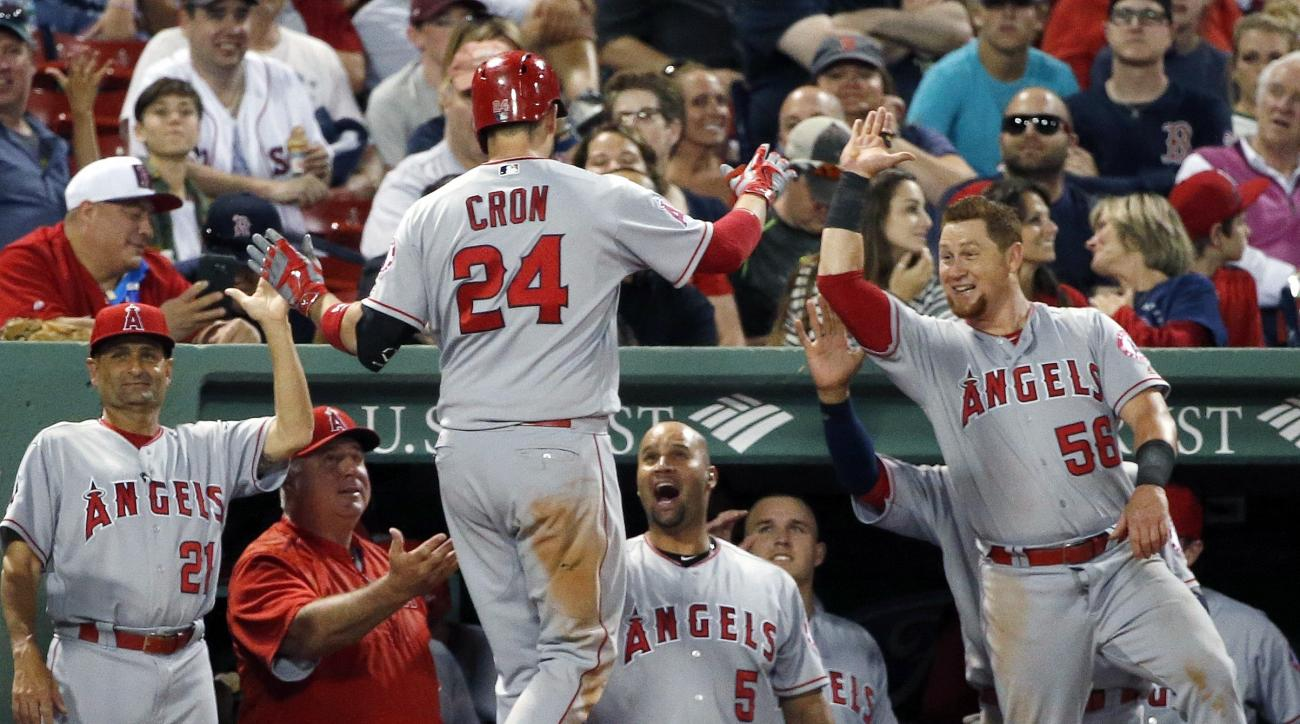 Los Angeles Angels' C.J. Cron (24) celebrates his two-run home run during the seventh inning of a baseball game against the Boston Red Sox in Boston, Saturday, July 2, 2016. (AP Photo/Michael Dwyer)