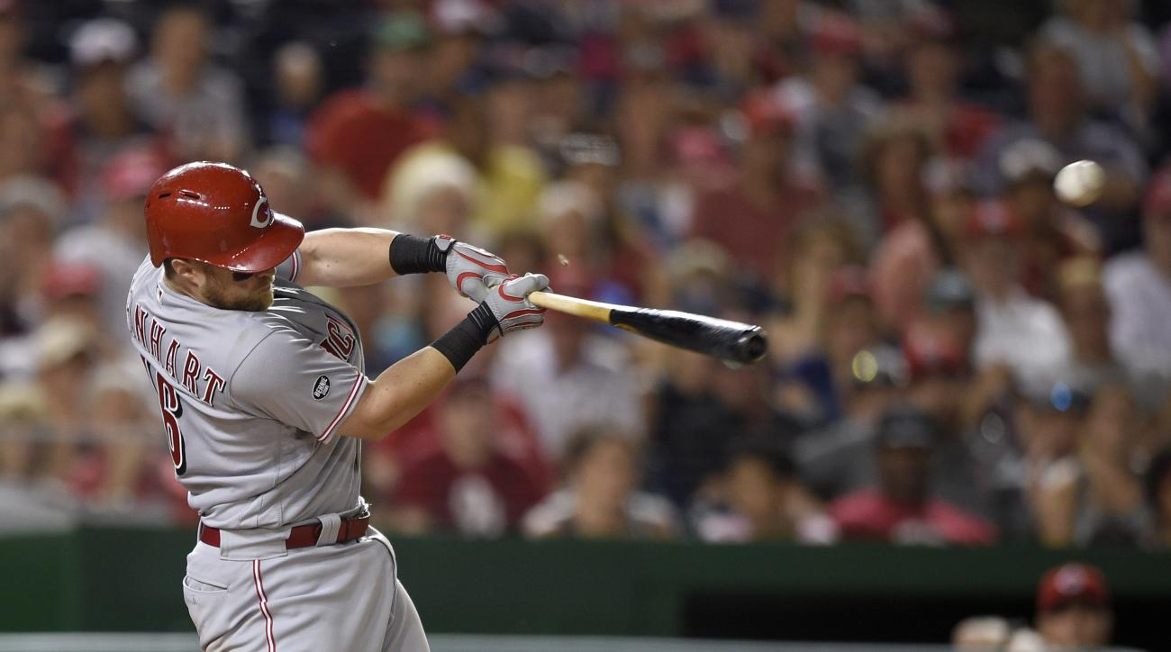 Cincinnati Reds' Tucker Barnhart singles in two runs during the 10th inning of a baseball game against the Washington Nationals, Saturday, July 2, 2016, in Washington. The Red won 9-4. (AP Photo/Nick Wass)