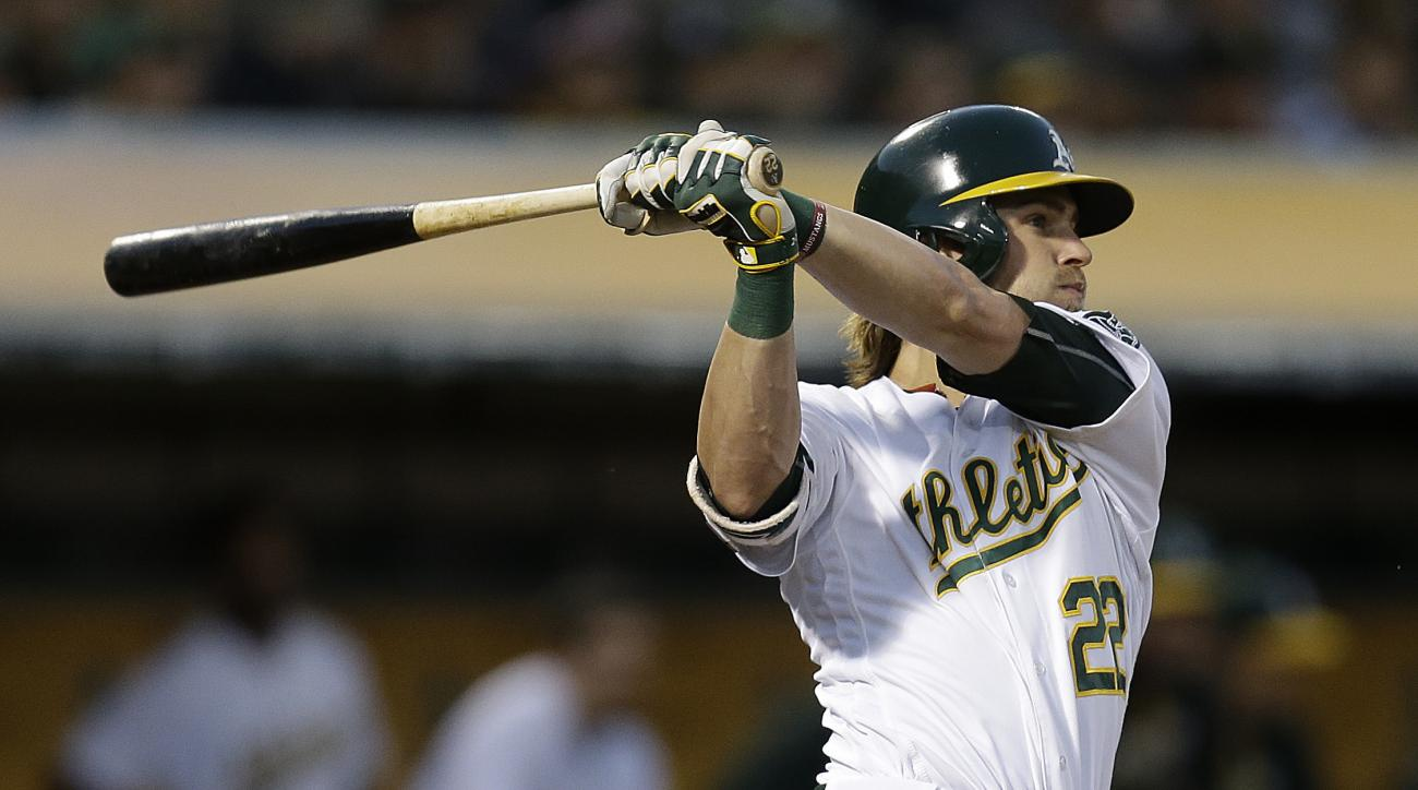 Oakland Athletics' Josh Reddick swings for a double in the fifth inning of a baseball game against the Pittsburgh Pirates, Saturday, July 2, 2016, in Oakland, Calif. (AP Photo/Ben Margot)