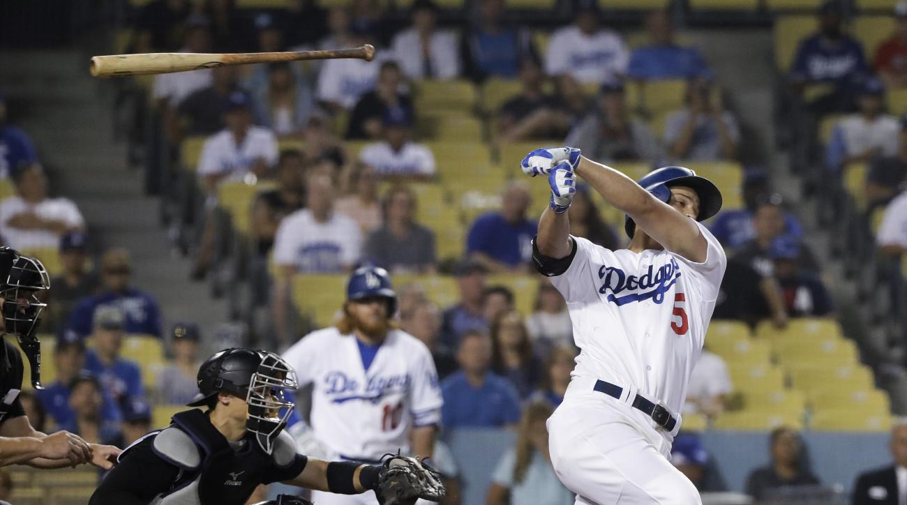 The bat slips out of the hands of Los Angeles Dodgers' Corey Seage during the eighth inning of a baseball game against the Colorado Rockies, Saturday, July 2, 2016, in Los Angeles. (AP Photo/Jae C. Hong)