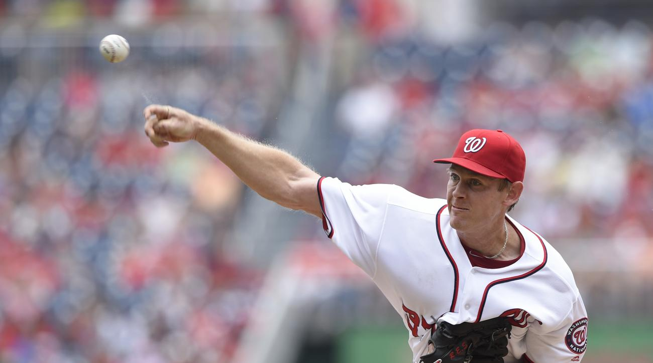 Washington Nationals starting pitcher Stephen Strasburg delivers during the first inning of a baseball game against the Cincinnati Reds, Sunday, July 3, 2016, in Washington. (AP Photo/Nick Wass)