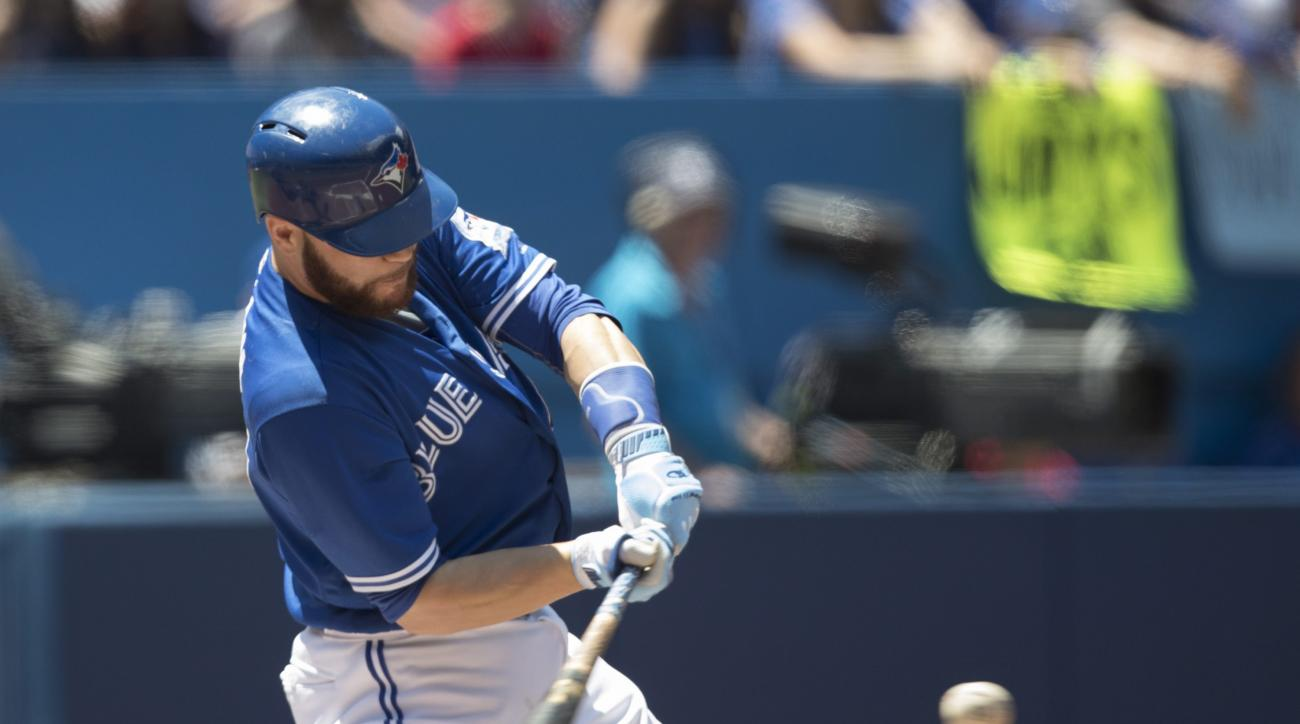 Toronto Blue Jays' Russell Martin hits a three-run home run against the Cleveland Indians during first inning baseball action in Toronto on Sunday, July 3, 2016. (Fred Thornhill/The Canadian Press via AP)