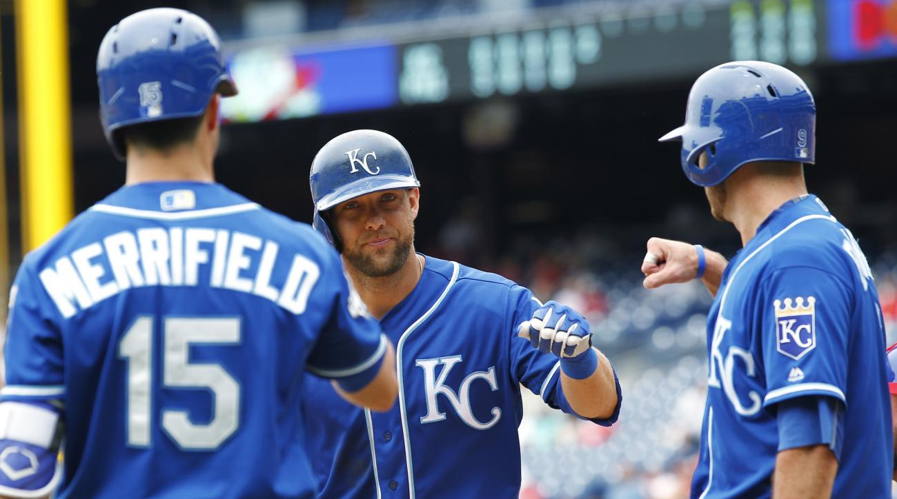 Kansas City Royals' Alex Gordon, center, is greeted at the plate by Whit Merrifield, left, and Drew Butera, right, after hitting a two-run homer during the fifth inning of a baseball game against the Philadelphia Phillies, Sunday, July 3, 2016 in Philadel