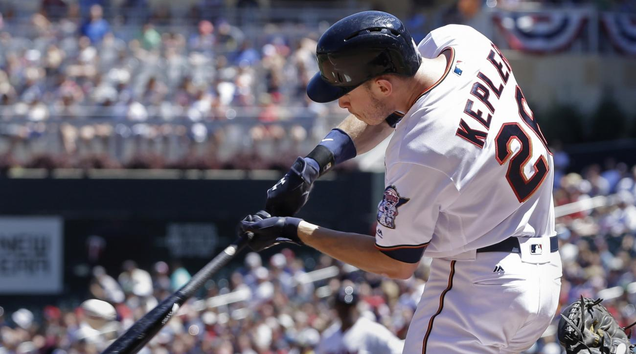 Minnesota Twins' Max Kepler hits an RBI single off Texas Rangers pitcher Cole Hamels in the fifth inning of a baseball game, Sunday, July 3, 2016, in Minneapolis. (AP Photo/Jim Mone)