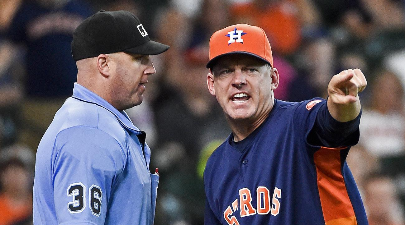 Houston Astros manager A.J. Hinch, right, argues with home plate umpire Ryan Blakney after Blakney ejected him from the baseball game in the seventh inning against the Chicago White Sox, Sunday, July 3, 2016, in Houston. (AP Photo/Eric Christian Smith)