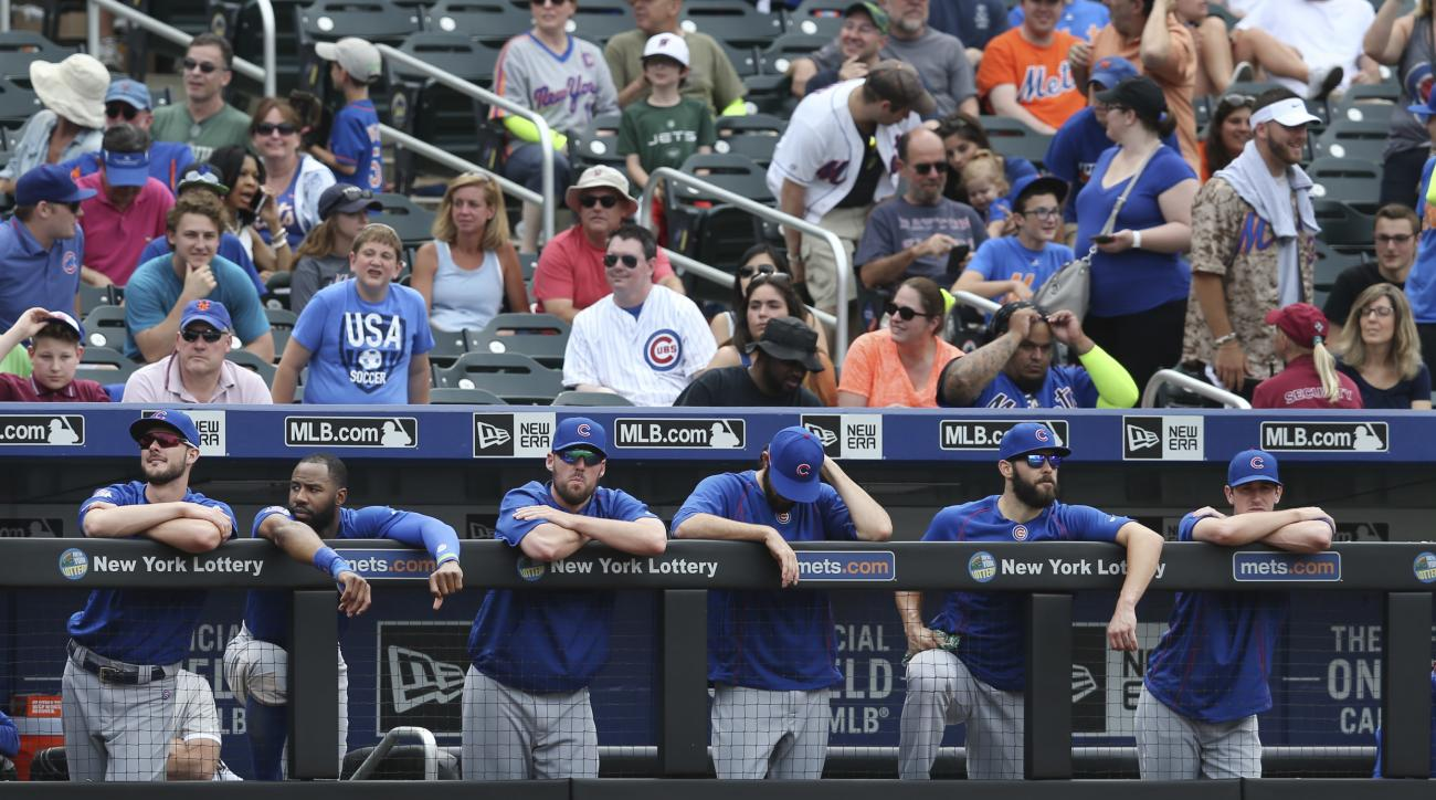 wbChicago Cubs players watch from the dugout during the ninth inning of the baseball game against the New York Mets, Sunday, July 3, 2016, in New York. (AP Photo/Seth Wenig)