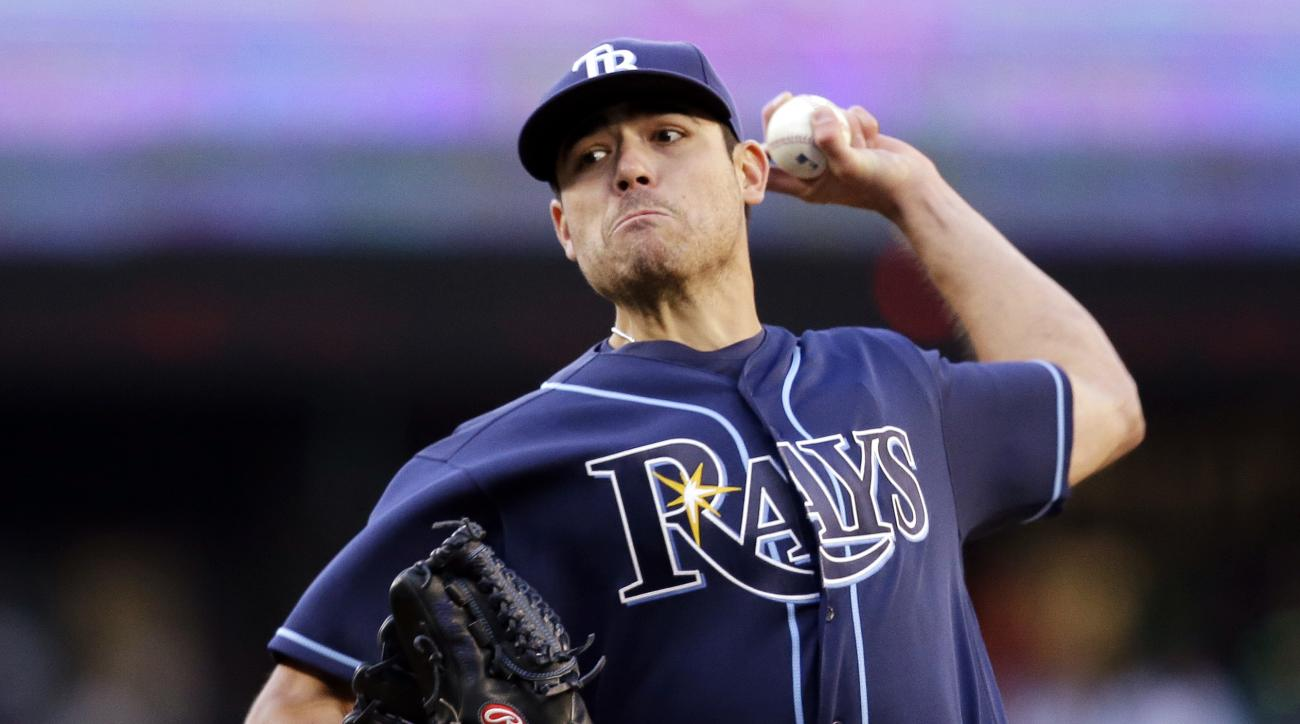 FILE - In this May 9, 2016, file photo, Tampa Bay Rays starting pitcher Matt Moore throws against the Seattle Mariners in the first inning of a baseball game in Seattle. Moore (4-5) faces the Los Angeles Angels for the first time since September 2013, whe