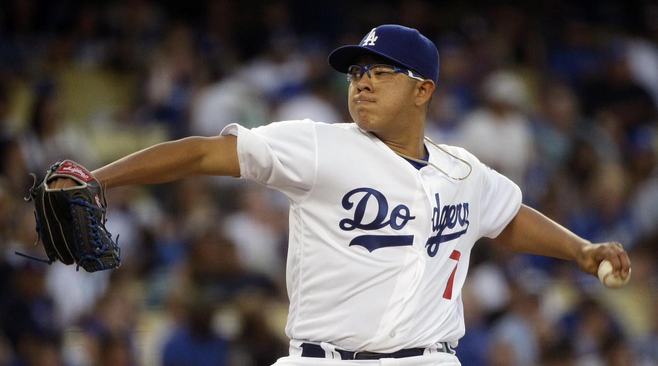 FILE - In this June 17, 2016, file photo, Los Angeles Dodgers starting pitcher Julio Urias throws against the Milwaukee Brewers during the second inning of a baseball game in Los Angeles. Urias (1-2), the Dodgers' 19-year-old left-hander, makes his eight