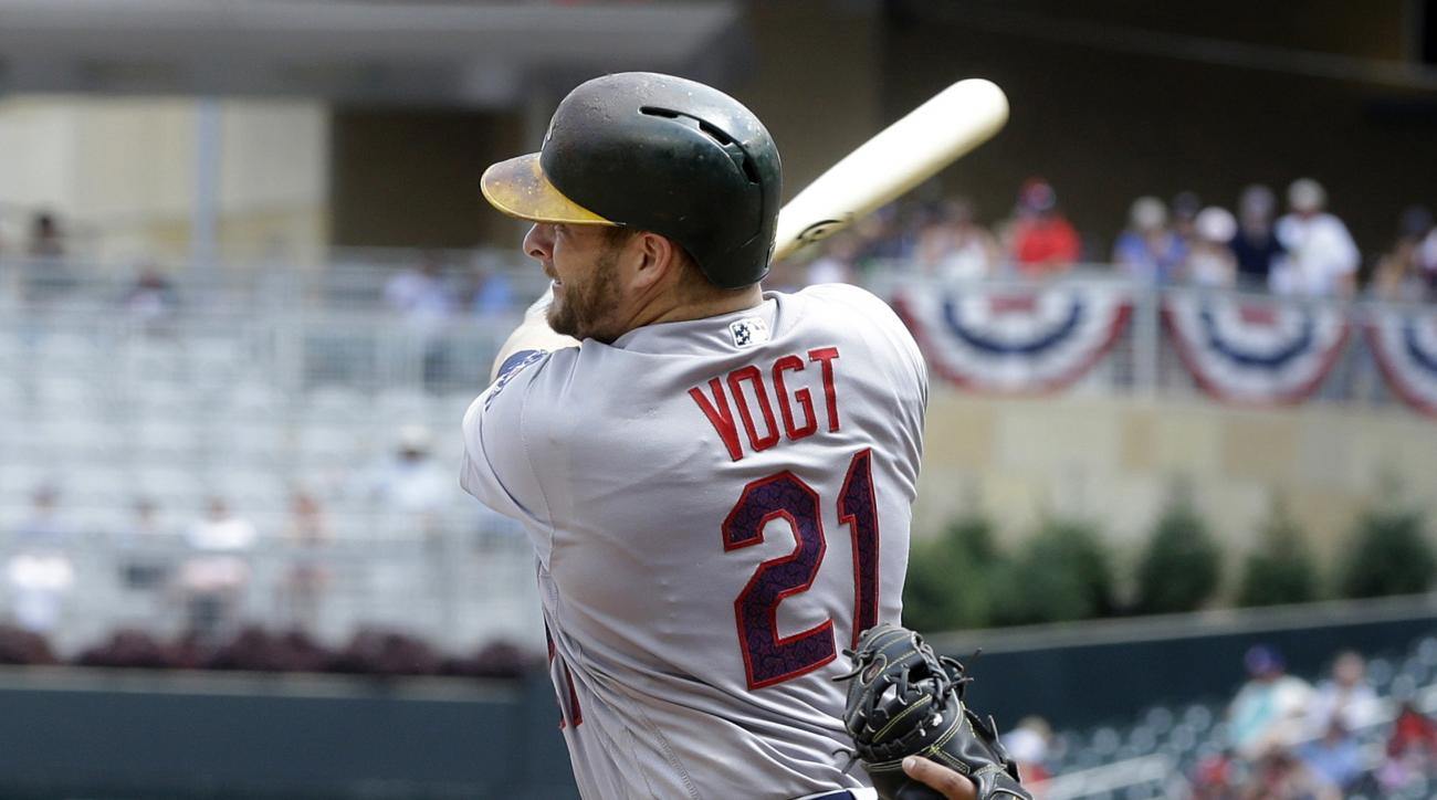Oakland Athletics' Stephen Vogt drives in a run off Minnesota Twins pitcher Taylor Rogers to tie the baseball game in the seventh inning of a baseball game Monday, July 4, 2016, in Minneapolis. (AP Photo/Jim Mone)