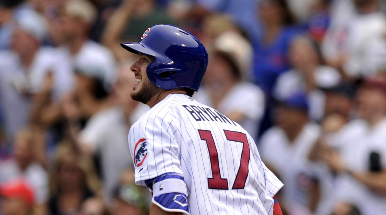 Chicago Cubs' Kris Bryant watches his two-run home during the second inning of a baseball game against the Cincinnati Reds, Monday, July 4, 2016, in Chicago. (AP Photo/Paul Beaty)