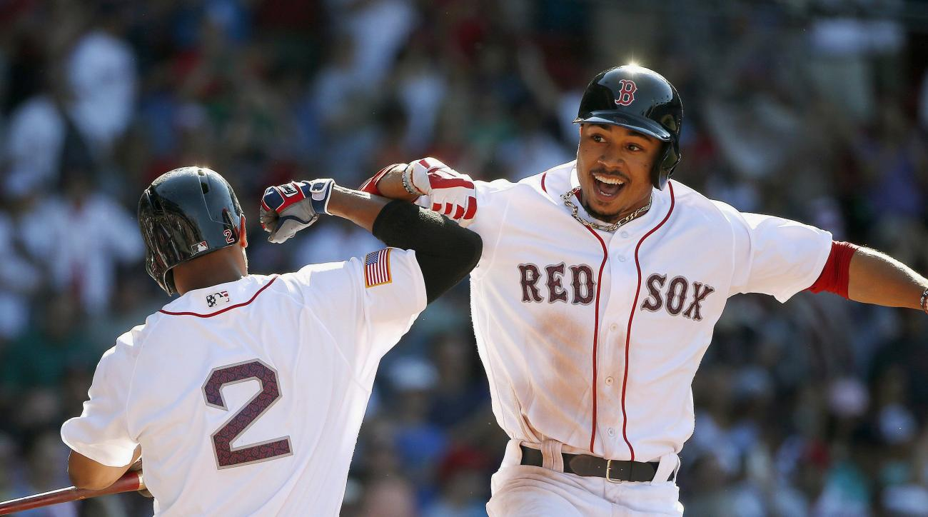 Boston Red Sox's Mookie Betts, right, celebrates his two-run home run with Xander Bogaerts (2) during the eighth inning of a baseball game against the Texas Rangers in Boston, Monday, July 4, 2016. (AP Photo/Michael Dwyer)