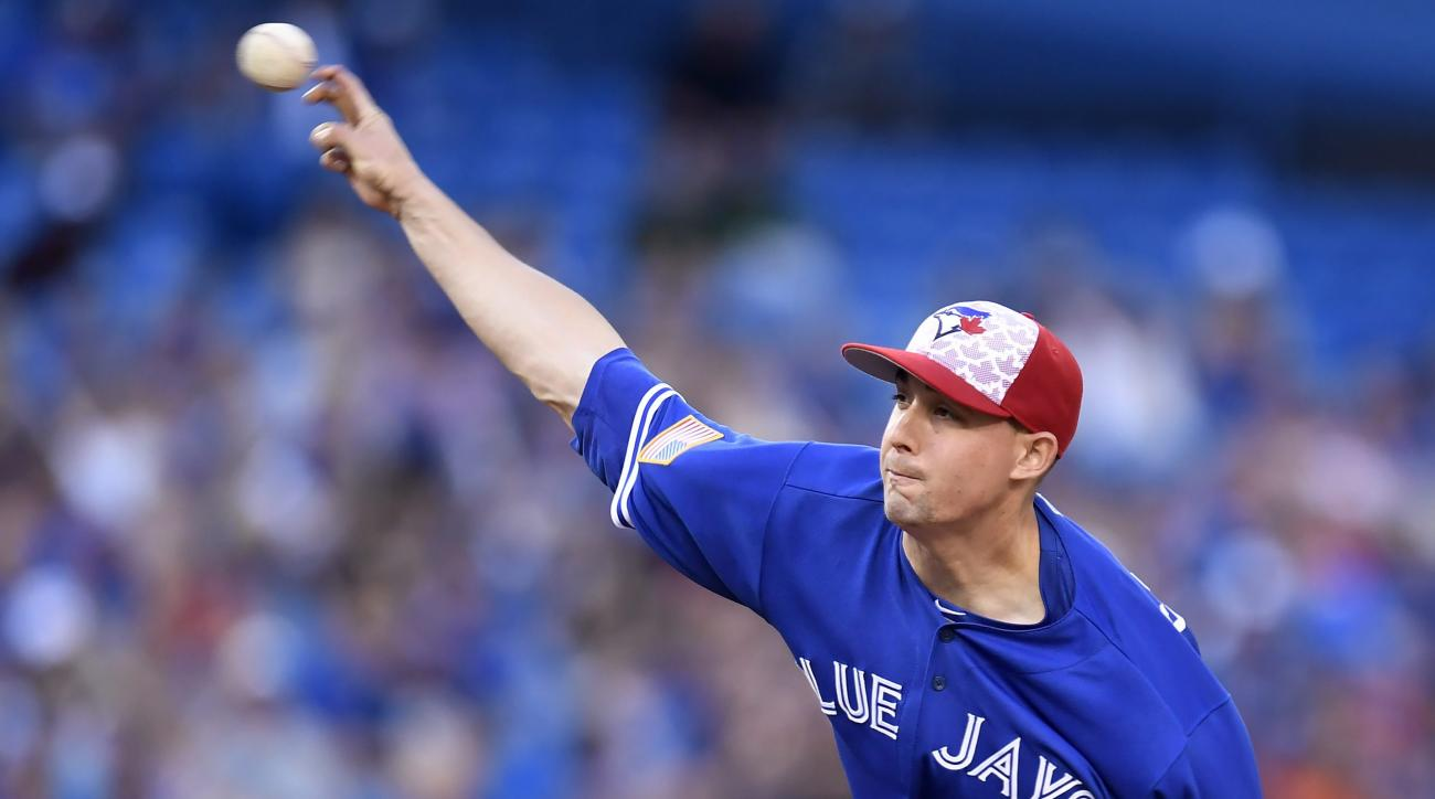 Toronto Blue Jays' Aaron Sanchez works against the Kansas City Royals during the second inning of a baseball game in Toronto, Monday, July 4, 2016. (Frank Gunn/The Canadian Press via AP)