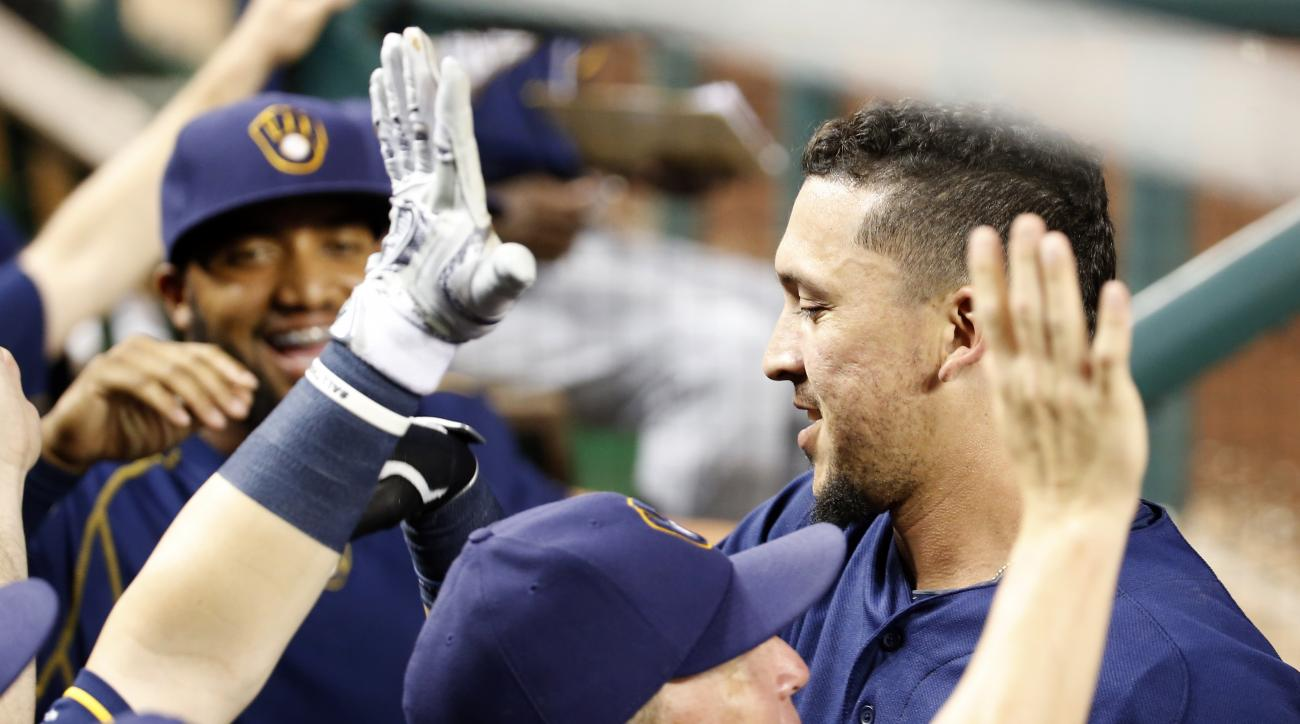 Milwaukee Brewers' Hernan Perez, right, celebrates his two run homer with his teammates during the sixth inning of a baseball game against the Washington Nationals at Nationals Park, Tuesday, July 5, 2016, in Washington. (AP Photo/Alex Brandon)