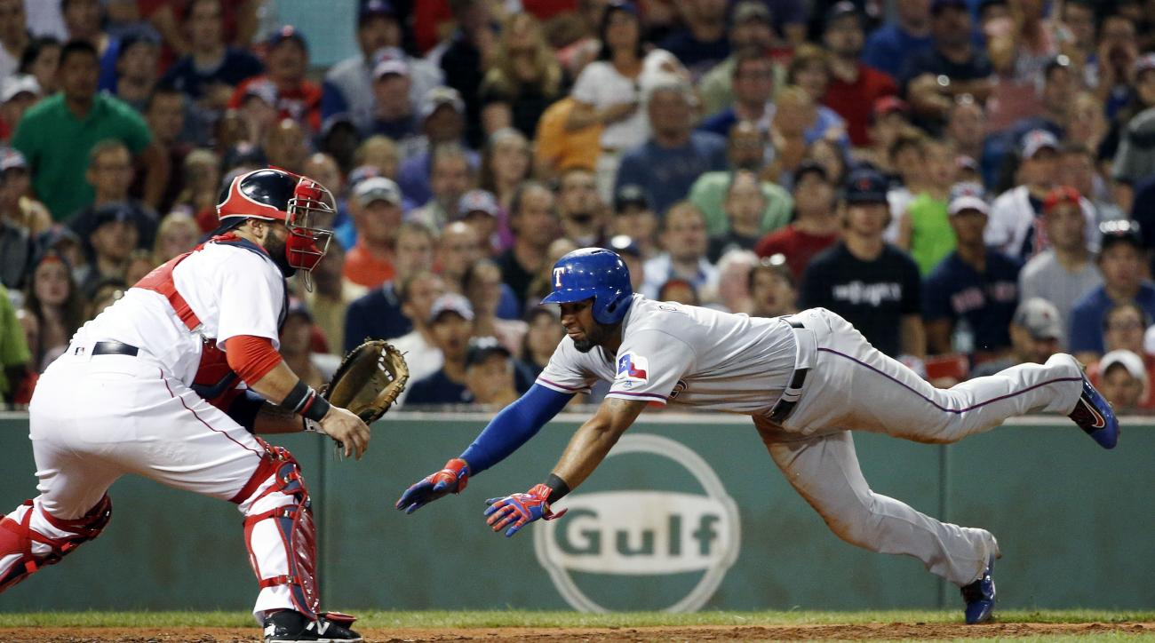 Texas Rangers' Elvis Andrus, right, scores on a double by Rougned Odor as Boston Red Sox's Sandy Leon waits for the throw during the sixth inning of a baseball game in Boston, Tuesday, July 5, 2016. (AP Photo/Michael Dwyer)