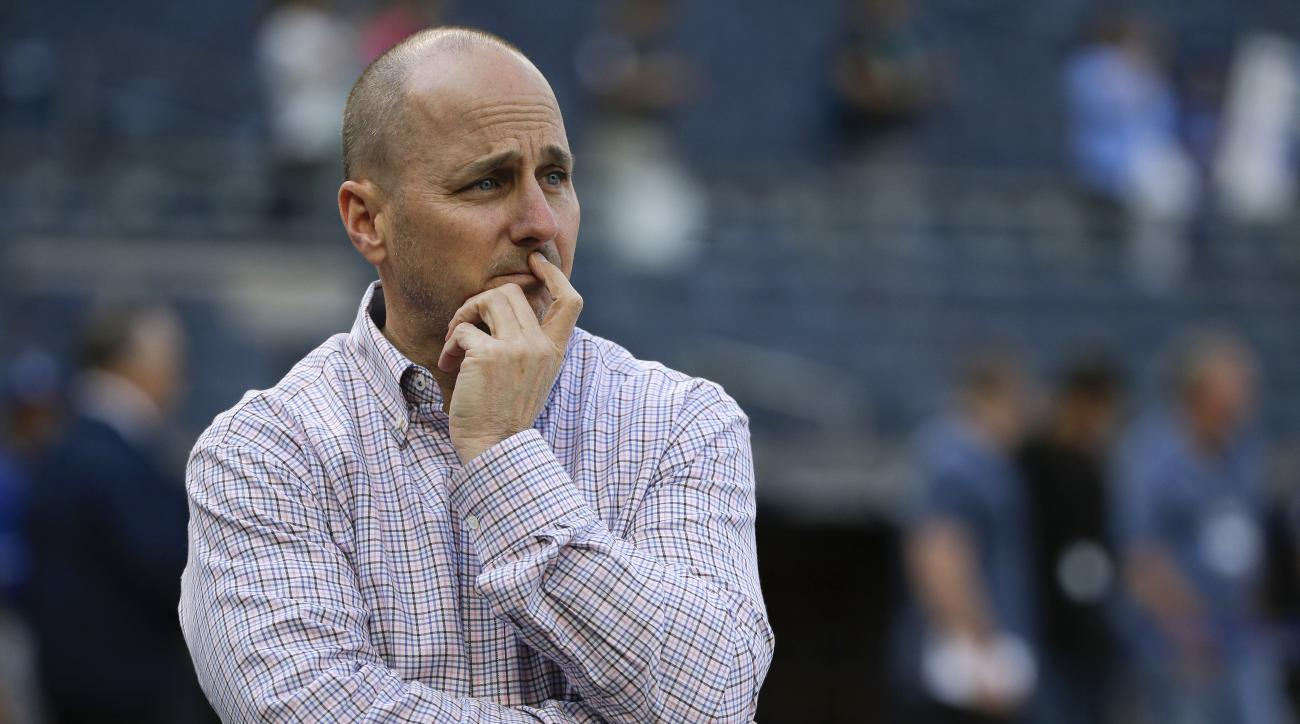 FILE - In this May 12, 2016, file phtoo, New York Yankees general manager Brian Cashman watches batting practice before the team's baseball game against the Kansas City Royals in New York.With his team around the .500 mark since late May, Cashman said Tue