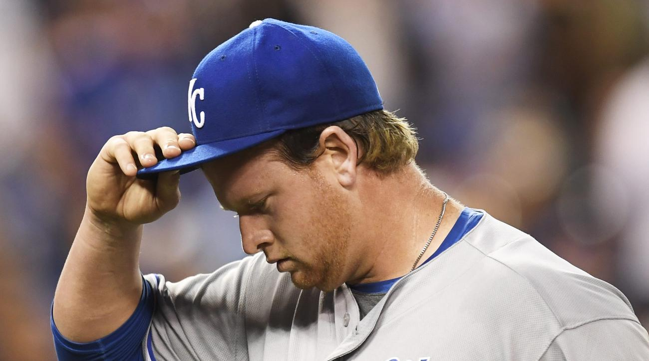 Kansas City Royals pitcher Brooks Pounders walks off the field after seventh inning of a baseball game against the Toronto Blue Jays in Toronto on Tuesday, July 5, 2016. (Frank Gunn/The Canadian Press via AP)