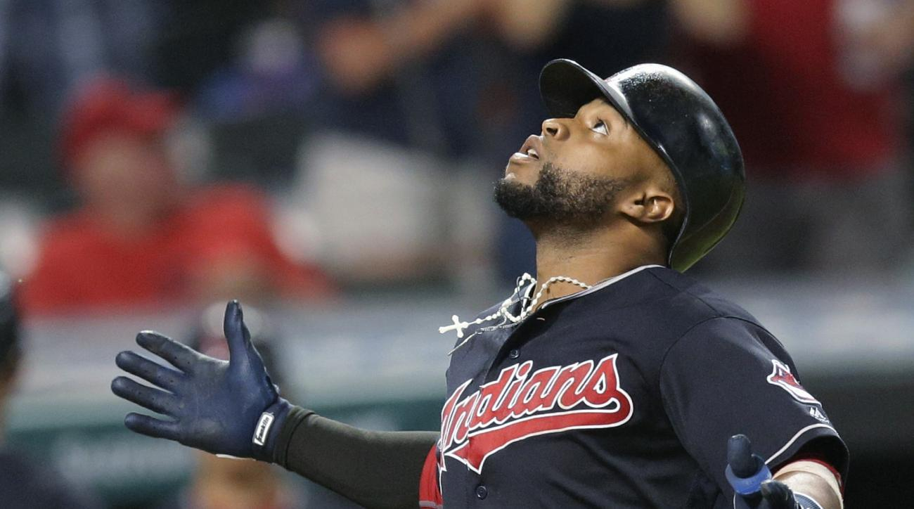 Cleveland Indians' Carlos Santana looks up as he runs the bases after hitting a solo home run off Detroit Tigers relief pitcher Mark Lowe during the eighth inning of a baseball game, Tuesday, July 5, 2016, in Cleveland. (AP Photo/Tony Dejak)
