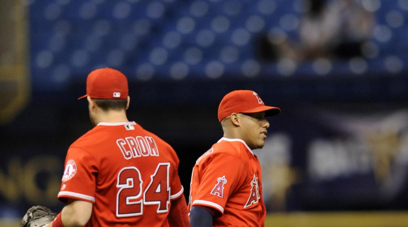 Los Angeles Angels' C.J. Cron (24) and Yunel Escobar celebrate the teams' 13-5 win over the Tampa Bay Rays in a baseball game Tuesday, July 5, 2016, in St. Petersburg, Fla. (AP Photo/Steve Nesius)