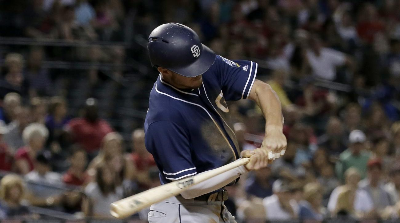 San Diego Padres' Wil Myers connects for a base hit during the fifth inning of a baseball game against the Arizona Diamondbacks, Tuesday, July 5, 2016, in Phoenix. (AP Photo/Matt York)